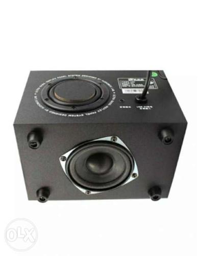 2.1 channel, 2 speakers, 1 subwoofer, built in