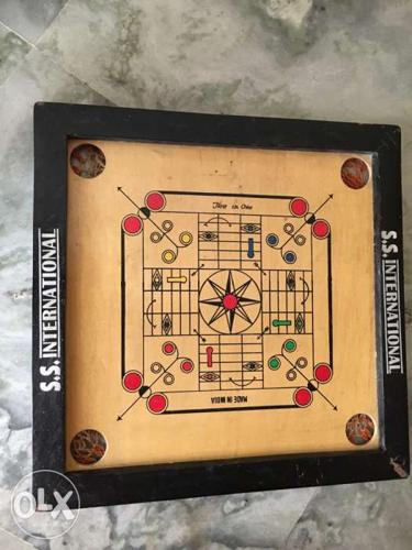 A junior carrom board manufactured by S S International