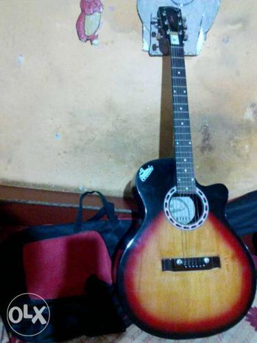 A new guitar with bag and belt... Hurry up!