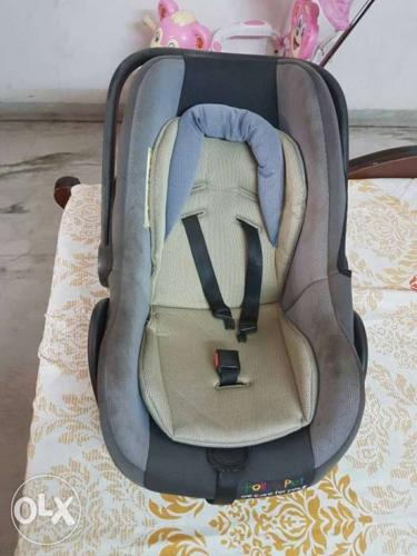 Baby's Gray, Blue And Yellow Car Seat