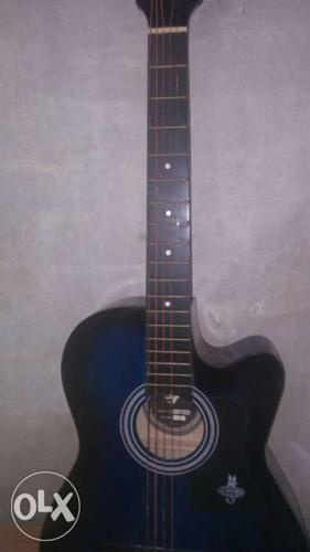 Black And Blue Wooden Cutaway Acoustic Guitar