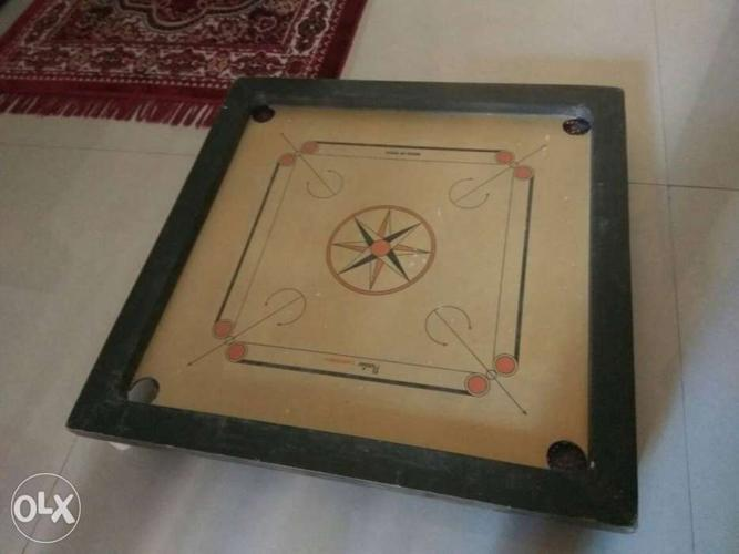 Brown And Black Carrom Board