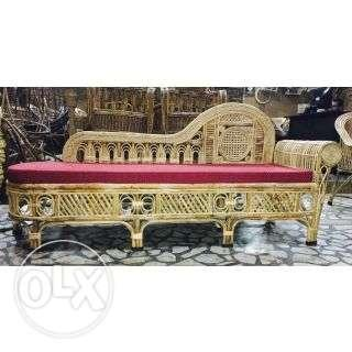Brown Rattan Framed Red Padded Sofa