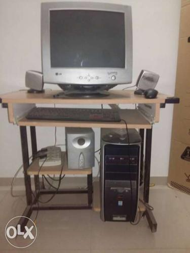 Desktop computer with speakers and woofers TV and