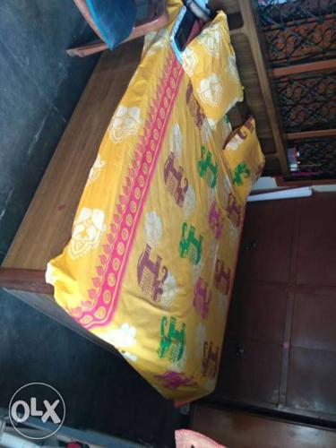 Double bed with storage and dining table with six