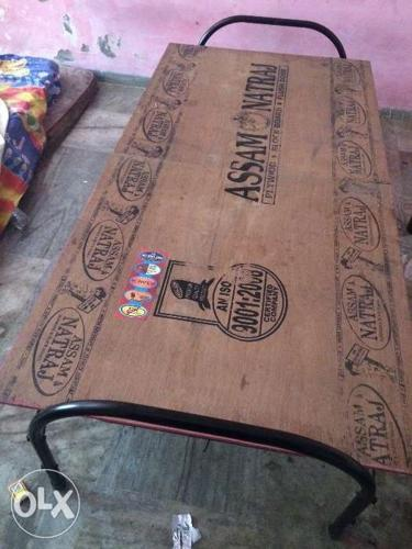 Folding plywood bed in good condition