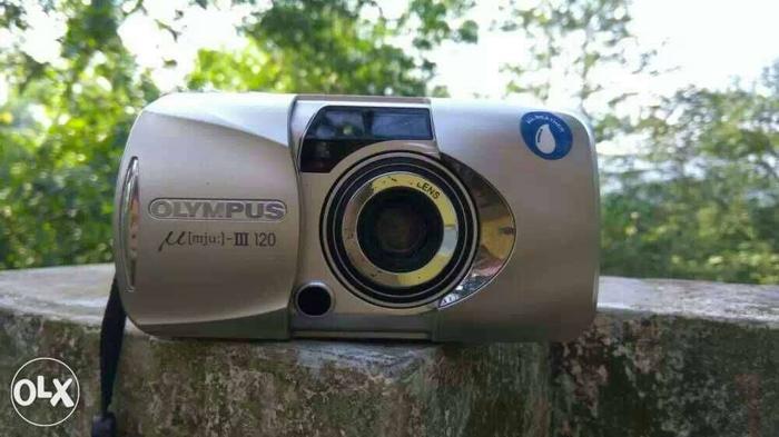 Gray Olympus Compact Camera