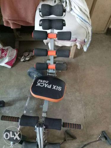 Gray Steel Frame Black And Orange Six Pack Exercise