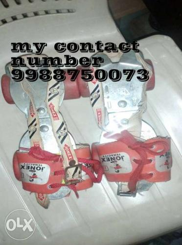 Pair Of Silver And Red JONEX Roller Blades