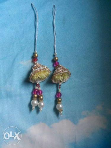 Pair Of Silver, Pearl And Gold Dangling rakhi