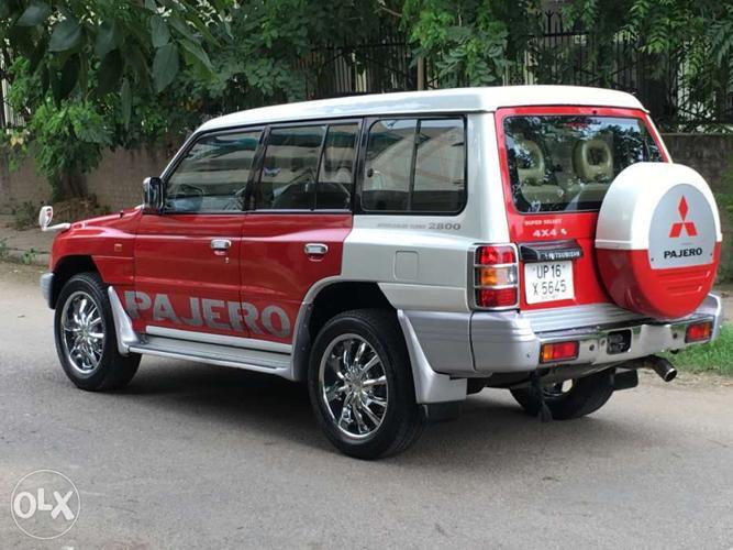 Pajero SFX 2009 red-white color