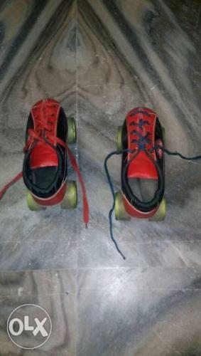 Red-and-black Roller Skates