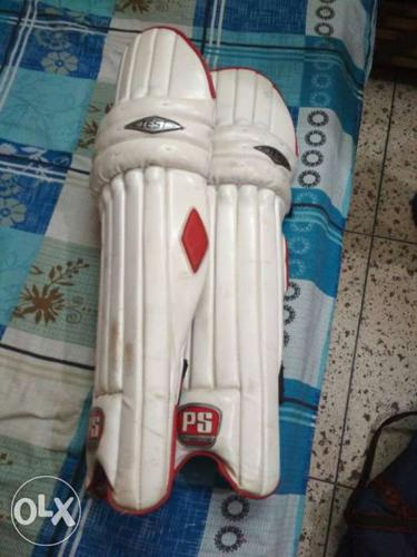 Red And White proshine leg guards in good quality