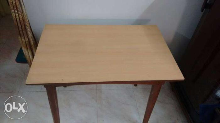 Rose wood table in perfect condition.