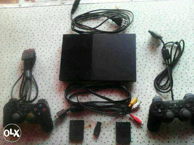 Sony playstation 2 with remonte memory card 16 gb