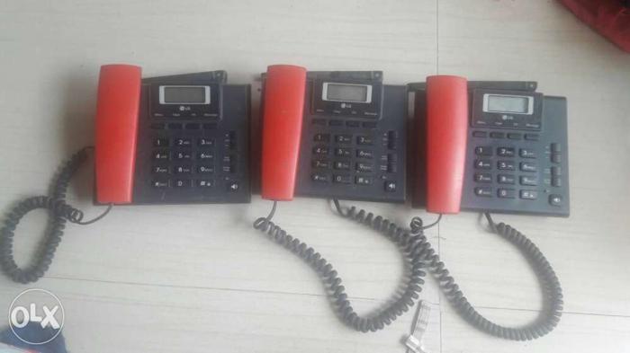 Three Red-and-black Ip Desk Telephones