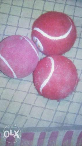 Three Red Tennis Balls