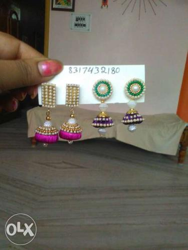 Two Pairs Of Pink And Purple Jhumka Earrings