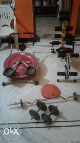 Two Red And Black Exercise Equipments