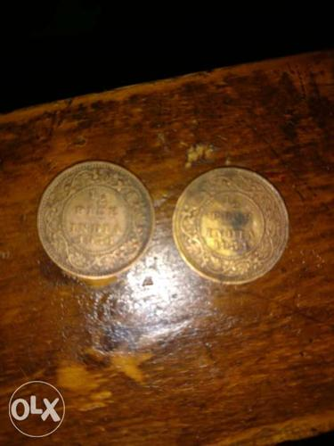 Two Round Gold-colored Coins 83 years old coin
