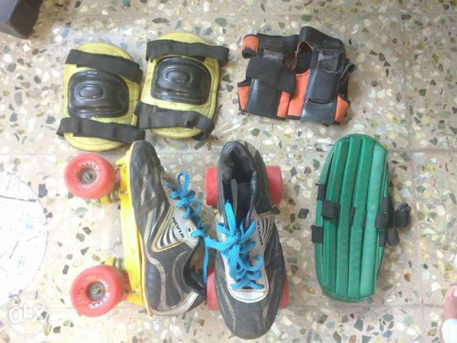 Used roller skates with hand knee n head guard.