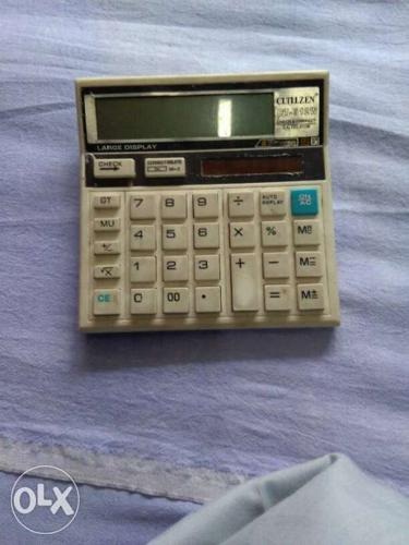 White And Black Electronic Calculator