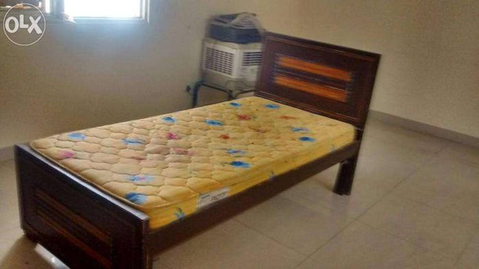 Wooden bed with matress