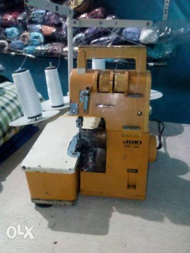 Yellow And White Juki Electric Sewing Machine overlook