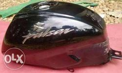 Bajaj pulsar 150 fuel tank black It got dent in it .. which will cost u 500 to repair it Price negotiable..
