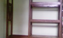 It is made of strong wood. It has 2 bars for keeping clothes using hangers. It also has a no. of sections for hanging clothes. It also has a cupboard below for keeping household items. It is in a good shape with no damage and is about 10 years old.