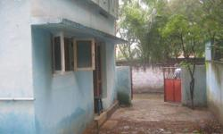 East facing Concrete 1bedroom with attached toilet, hall and kitchen with vacant space on front and side, compounded, 16 ft concrete road, low budget