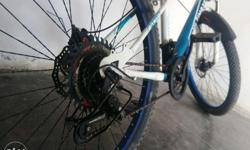 Well maintained and in running condition. Type:- MTB Mountain bike with 9 gear shift front and rear both. Brakes:- Powerful disk brakes rear and front. (Both sides) Tyres:- Wide tyres with extra grip. Colour:- Blue and White colour combination. Weight:-