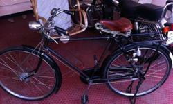 Raleigh bicycle Nottingham England with original paint , original rim and spokes, front drum brake , back 3 speed drum brake, original fairylites reflector, original pump, original pedal , original carrier and stand , original brooks saddle, etc