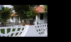 """Per Seraulim Colva """"Stain Glass Cottage"""" Active home stay/guesthouse. 5bedroom independant bungalow with laundry, loft attic,well, large balconies and landscaped garden. Access by 2 roads. 350sqm builtup on 630sqm plot area. Fully furnished with teakwood"""