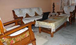 Wooden Sofa Set with Center Table. In very good condition.