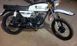 i frnds i am selling my yamaha rx 100 black and white beauty which is fully modified bike with genuine spare parts, new treys, in new look yamaha rx 100 .plz contact for best deal .