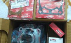 Brand New Yamaha RX 100 Genuine Bore Cylinder Kit. Including piston, Rings, Head packing and bore cylinder packing.