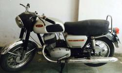 Its an antique bike with original 2 sillencers of 250 cc in a very awsome condition..all papers are completed with insurance done..