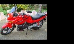 Iam selling my red coloured karizma r . its a show room