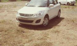 2013 model white colour swift dzire for sale. Excellent