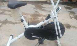 White And Black Stationary Bike new condition..6 mon.