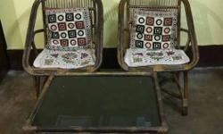 2 seater cane chair with centre table in good condition