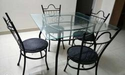 4 seater dining table set in wrought iron and glass. 3