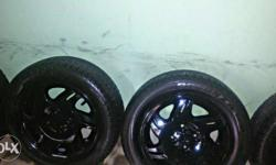 5 Alloys 14 inches gloxy black and 4 new tyre 185/60/14