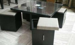 900mm x 900mm wooden table with glass top. All 4 seats