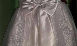 A beautiful communion dress used only once with a white