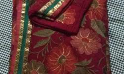 a new maroon red coloured saree with zari border at