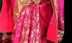 a beuatiful combination of rani pink silk sare with