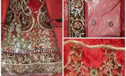 A New Bridal Red Lehnga with Designer Choli and