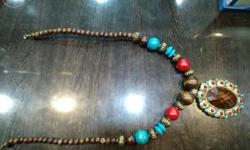 A classy brown necklace with a big brown stone embedded